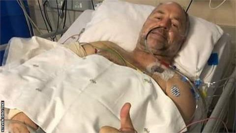 Naka Drotske giving a thumbs up from his hospital bed following the shooting