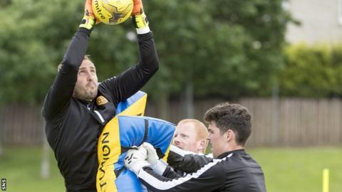 Dean Brill trains with Motherwell goalkeepers Craig Samson and Brett Long