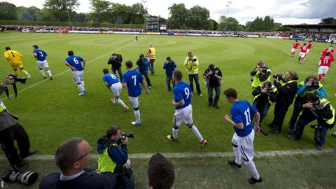 Rangers run on to Brechin City's Glebe Park for their first match since liquidation