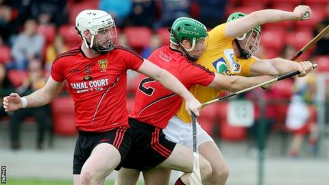 Down pair Conor O'Neill and Michael Hughes put Antrim's Matthew Donnelly under pressure in the final