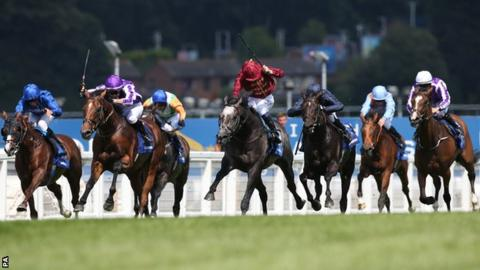 Horses in the closing stages of the Coral-Eclipse at Sandown