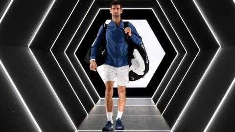 Novak Djokovic walks onto court ahead of the Paris Masters final against Karen Khachanov