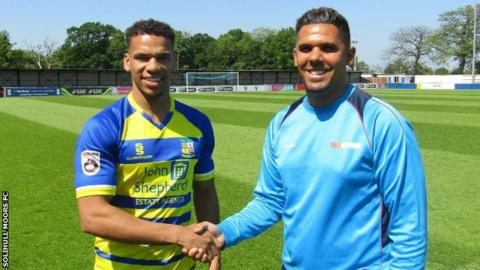 New signing Kalern Thomas is welcomed to Damson Park by Solihull manager Liam McDonald