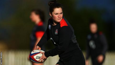 Poppy Leitch passes the ball in training