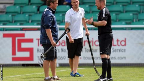 Referee David Rock speaks with Eastleigh ground staff before the match against Dagenham