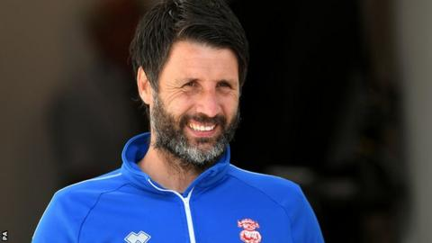 Lincoln manager Danny Cowley looks on
