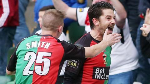 Glentoran's Curtis Allen celebrates after scoring an equaliser with the last kick of the game against Linfield