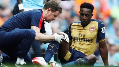 Danny Welbeck is treated at Etihad Stadium