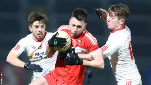 Peter Hagan of Derry attempts to escape the attention of Tyrone pair Ronan O'Neill and Mark Bradley