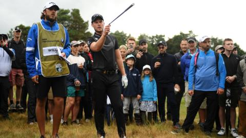 VIRGINIA WATER, ENGLAND - SEPTEMBER 22: Danny Willett of England speaks to his caddie during Day 4 of the BMW PGA Championship at Wentworth Golf Club on September 22, 2019 in Virginia Water, United Kingdom. (Photo by Harry Trump/Getty Images)