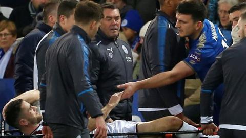 Burnley's Robbie Brady leaves the pitch on a stretcher while Leicester's Harry Maguire passes on his commiserations