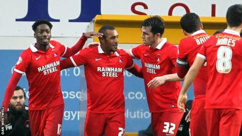 Leyton Orient's players celebrate their goal against Mansfield Town