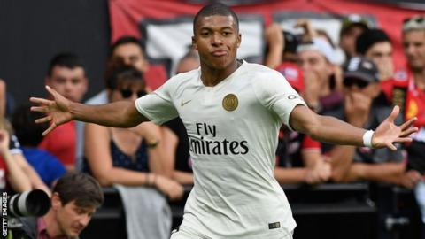 Kylian Mbappe celebrates scoring for Paris Saint Germain