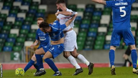 Dungannon's Chris Hegarty shields the ball from United striker Jonathan McMurray
