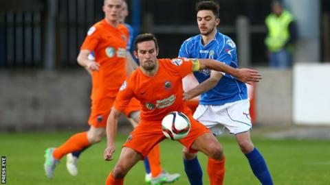 Linfield's Andrew Waterworth in action against Dave Montgomery of Dungannon
