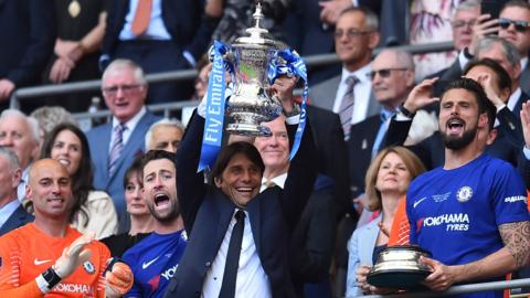 Chelsea manager Antonio Conte lifts the FA Cup