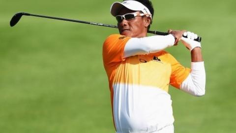 Thongchai Jaidee of Thailand plays a shot during the final round of the European Open