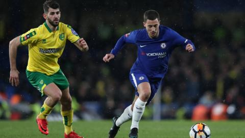 Hazard emerges with the ball