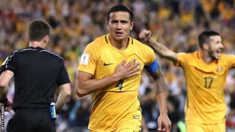 Tim Cahill celebrates scoring a goal for Australia