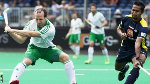 Peter Caruth prepares to score Ireland's second goal against Malaysia earlier this month
