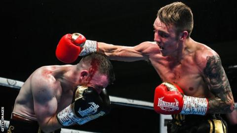 Jay Harris stopped Belfast's Paddy Barnes in four rounds to win the IBF Inter-Continental flyweight title