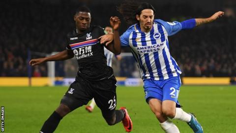Sullay Kaikai battles for the ball with Brighton defender Matias Schelotto