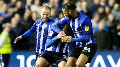 Adam Reach celebrates with team mates Barry Bannan and Michael Hector