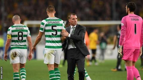 Celtic manager Brendan Rodgers consoles his players at full time in the Olympic Stadium