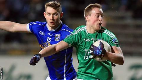 Cavan's David Givney battles with Fermanagh's Che Cullen