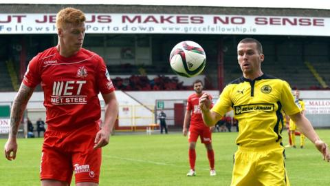 Chris Casement and Martin Donnelly in action during Cliftonville's 1-0 victory over Portadown at Shamrock Park