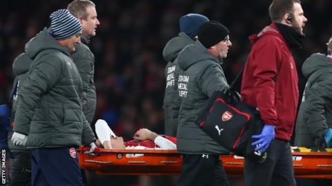 Hector Bellerin is carried off on a stretcher