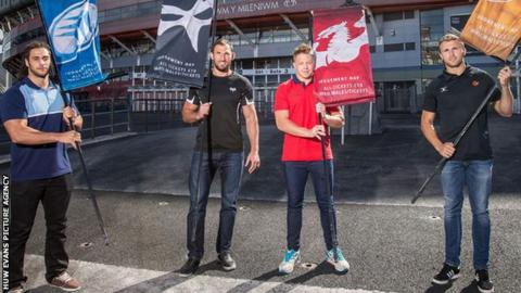 Players from all four Welsh regions pose with club flags