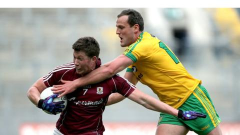 Gareth Bradshaw attempts to escape the clutches of Donegal captain Michael Murphy as the Ulster county run out 10-point winners