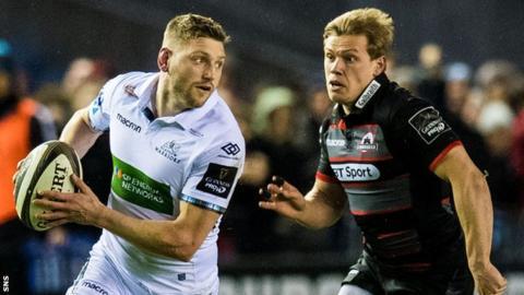 Glasgow's Finn Russell runs with the ball past Edinburgh's Nathan Fowles