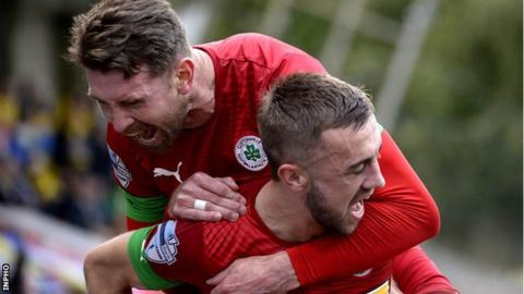 Cliftonville's Conor McMenamin celebrates his goal against Barry Town
