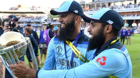 Adil Rashid (right) and Moeen Ali celebrate winning the World Cup
