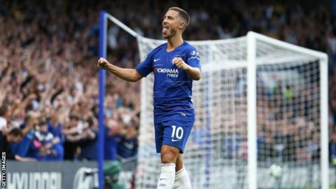 Eden Hazard celebrates after providing the assist for Marcos Alonso's winning goal in Chelsea's 3-2 win over Arsenal on 18 August 2018
