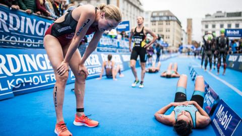 Hamburg, Germany, 7 July: Canada's Joanna Brown and her fellow competitors attempt to catch their breath at the finish line of the mixed relay in the latest leg of the World Triathlon Series. (Photo by Lukas Schulze/Getty Images)
