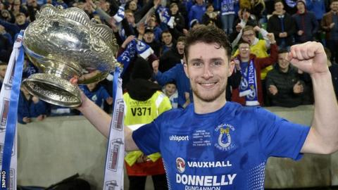 Ryan Mayse celebrates with the League Cup after helping Dungannon to victory over Ballymena in the final