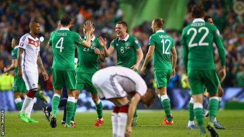 Republic of Ireland players celebrate scoring against Germany