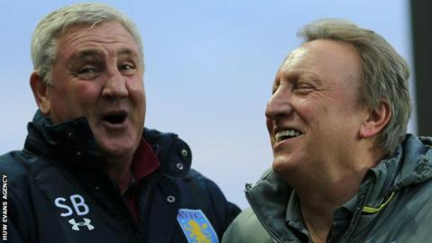 Neil Warnock (R) and Steve Bruce share a joke before kick off at Villa Park