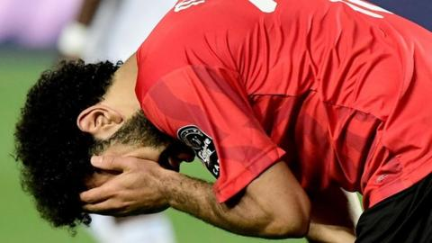 Mohamed Salah reacts to Egypt's early exit from the Nations Cup