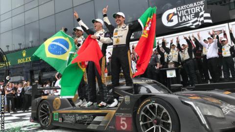 Filipe Albuquerque, Christian Fittipaldi and Joao Barbosa celebrate their win in the Daytona 24 Hours