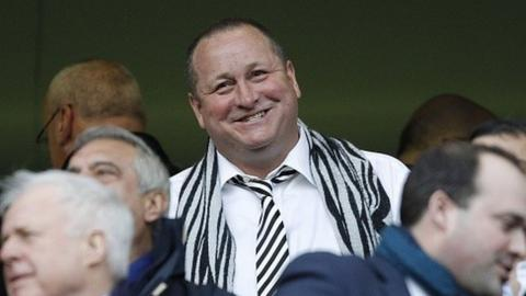 Mike Ashley wears a Newcastle scarf at a club game