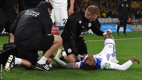 Leicester's Demarai Gray receives treatment after a heavy fall against Wolves