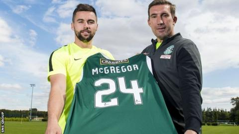 Darren McGregor shows off his new jersey with Hibs boss Alan Stubbs (right)