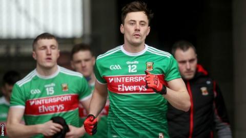 Mayo's Diarmuid O'Connor leads his team onto the field