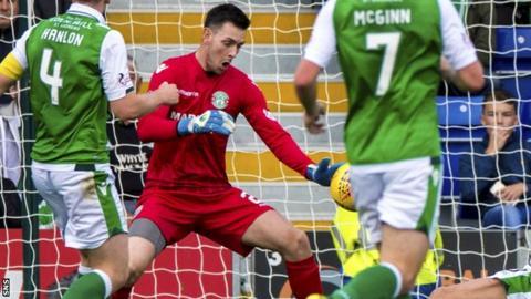 Ross Laidlaw makes a save for Hibernian