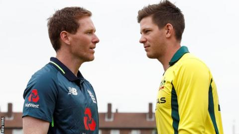 Eoin Morgan (left) with Tim Paine