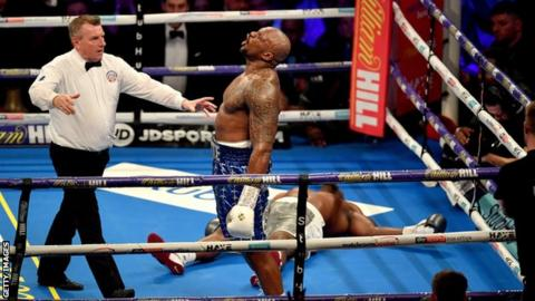 Dillian Whyte celebrates after knocking out Derek Chisora in December